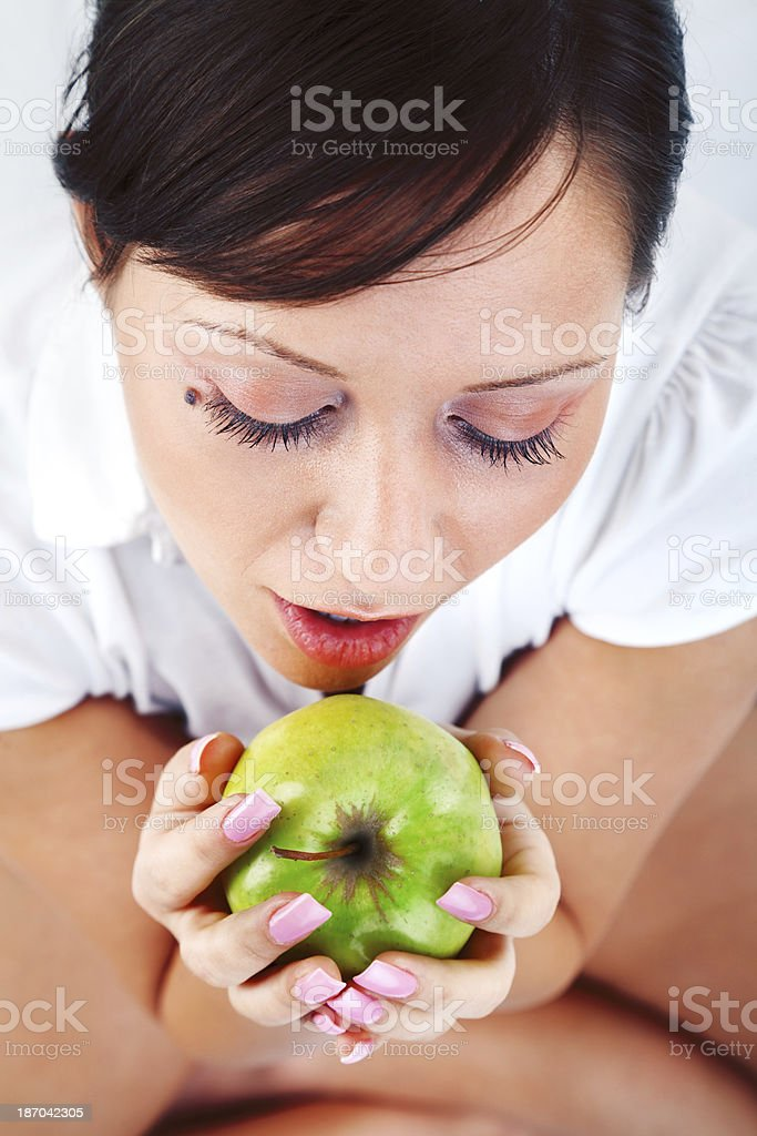 Young woman eating apple royalty-free stock photo