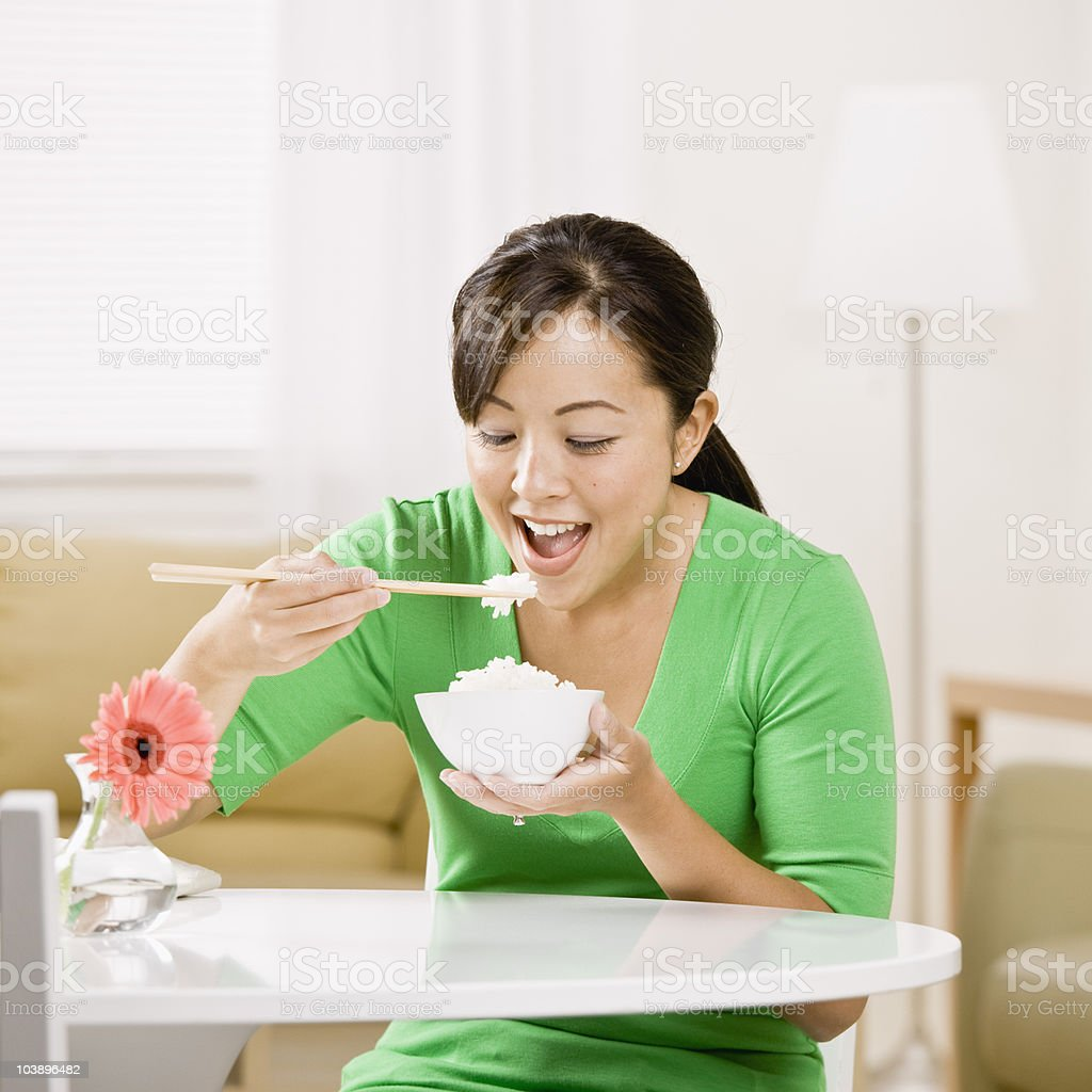 Young woman eating bowl of rice royalty-free stock photo