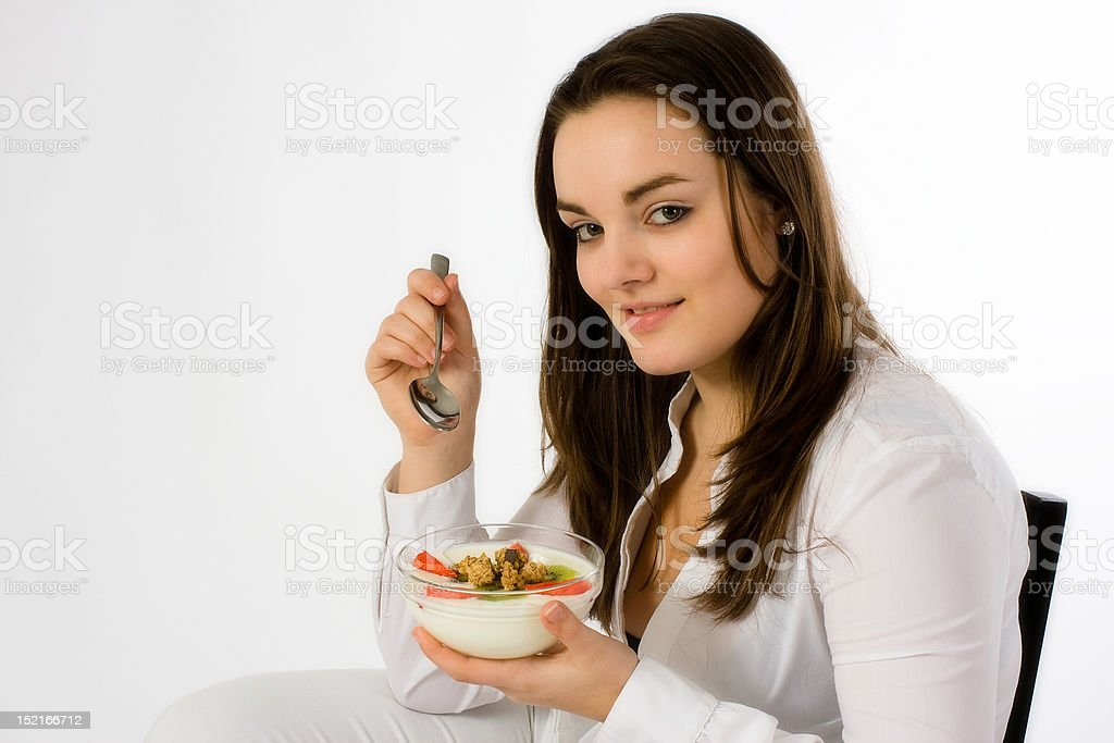 Young woman eating breakfast royalty-free stock photo