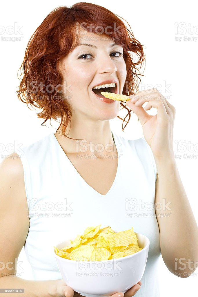 Young Woman Eating Chips stock photo