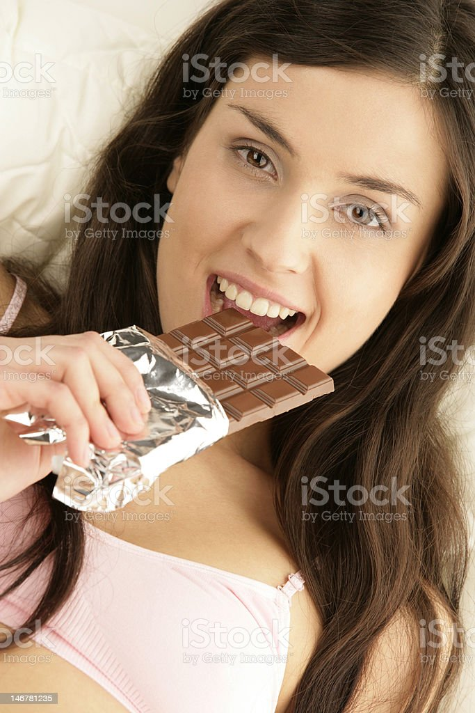 Young woman eating chocolate royalty-free stock photo