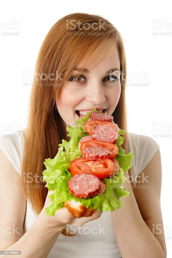 Young woman eating fast food royalty-free stock photo