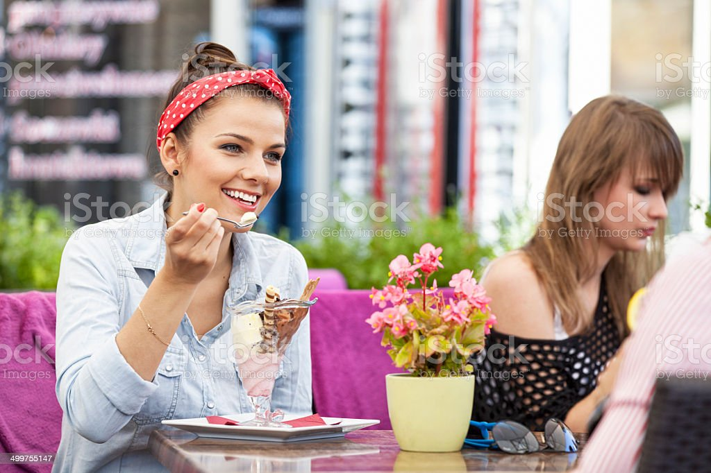 Young Woman Eating Ice Cream royalty-free stock photo