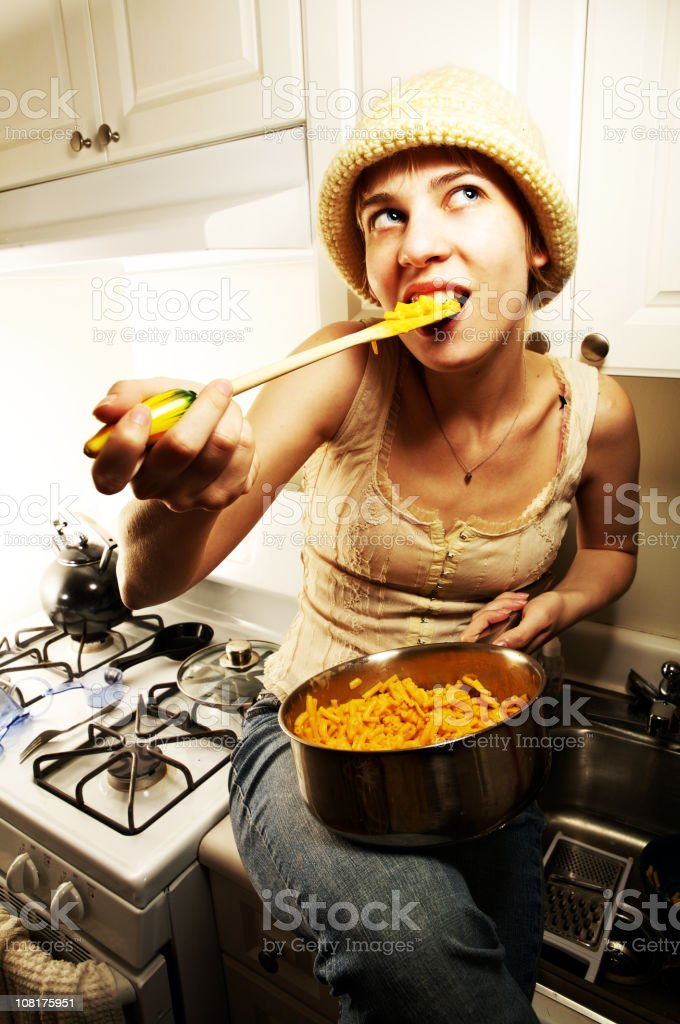 Young Woman Eating Macaroni and Cheese Out of Pot royalty-free stock photo