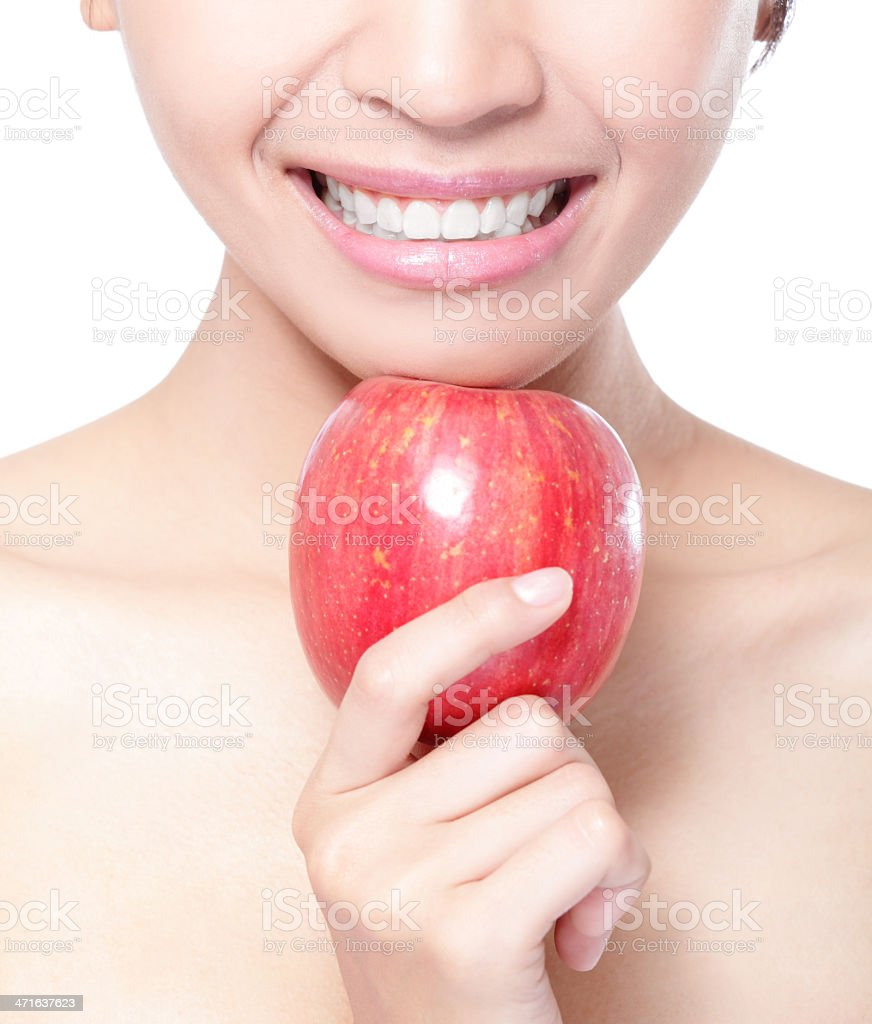 young woman eating red apple with health teeth royalty-free stock photo