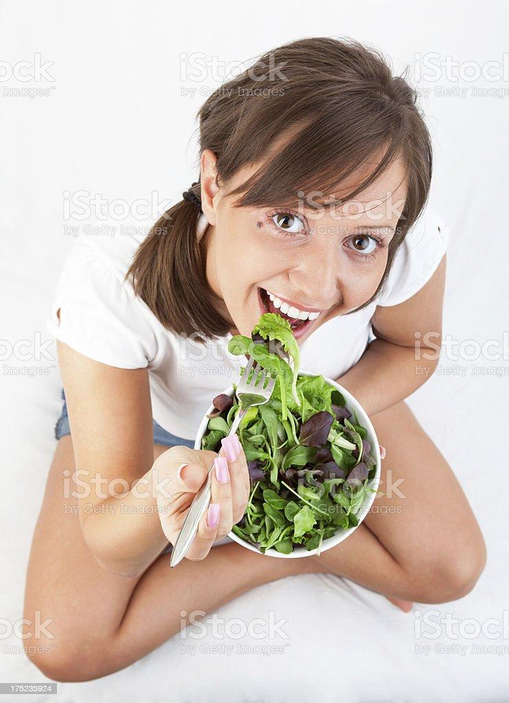 Young woman eating salad royalty-free stock photo
