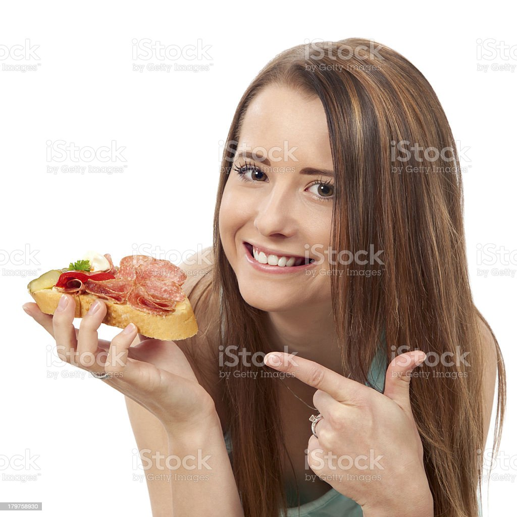 Young woman eating sandwich royalty-free stock photo