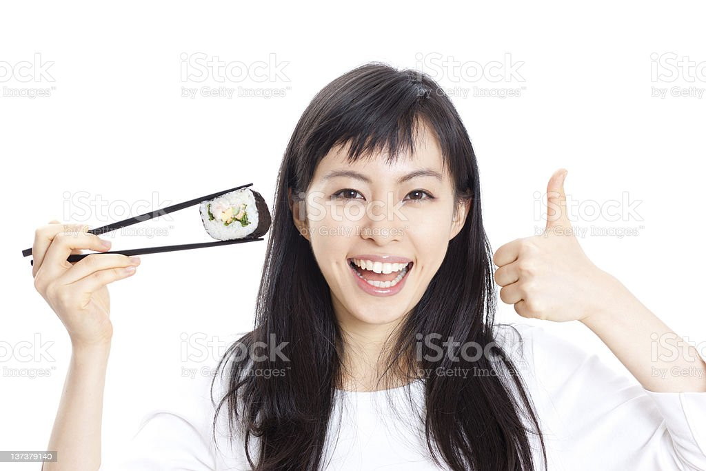 young woman eating sushi royalty-free stock photo
