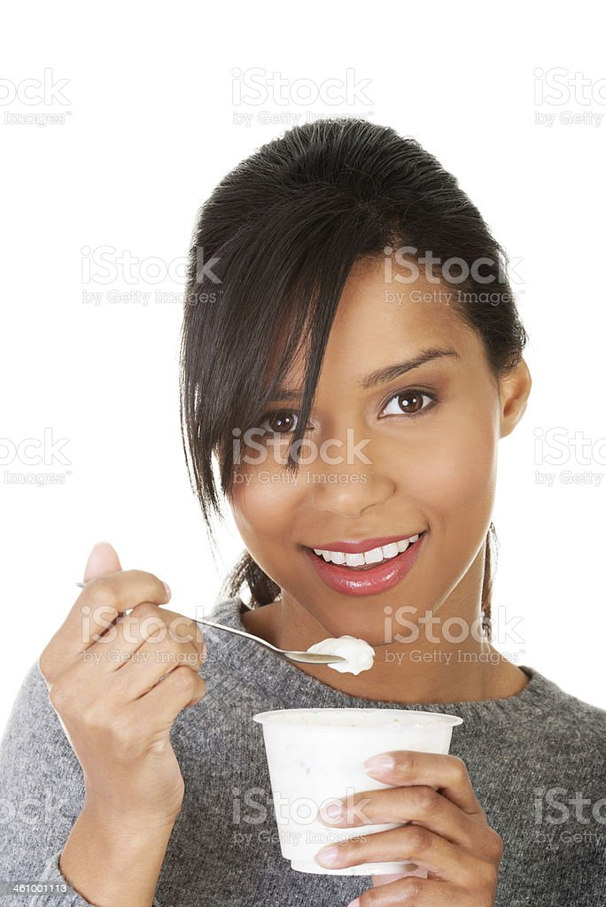 Young woman eating yogurt as healthy breakfast or snack. stock photo