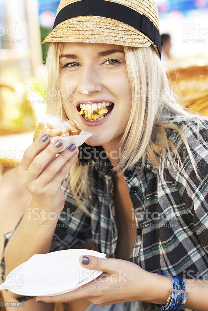 young woman eats muffin royalty-free stock photo