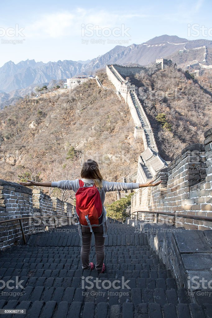 Young woman embracing nature-Great Wall of China stock photo