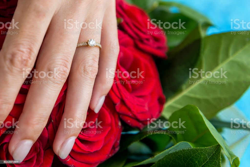 Young woman & engagement ring & bouquet stock photo