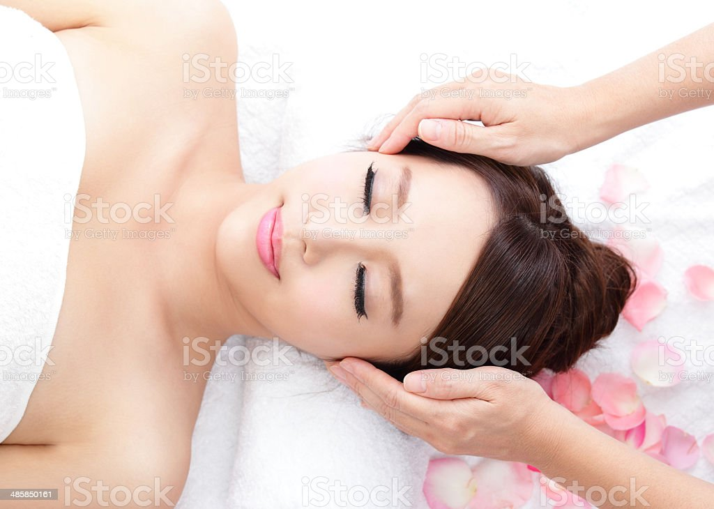 young woman enjoy massage at spa stock photo