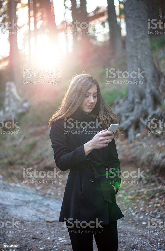 Young woman enjoying a autumn walk stock photo