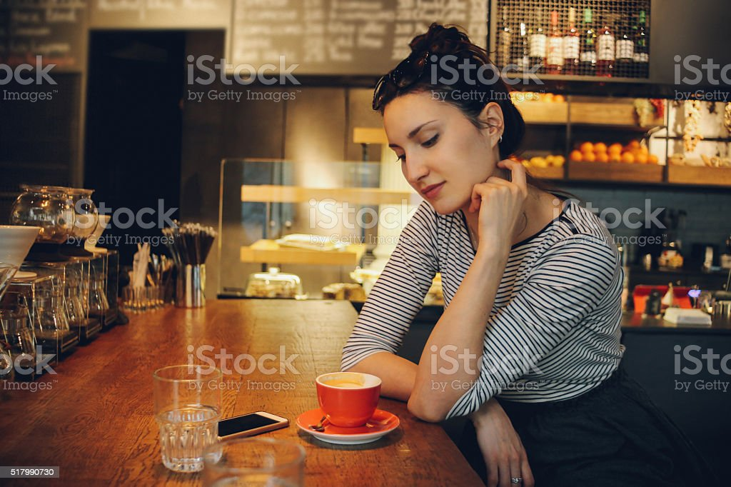 Young woman enjoying a coffee break stock photo