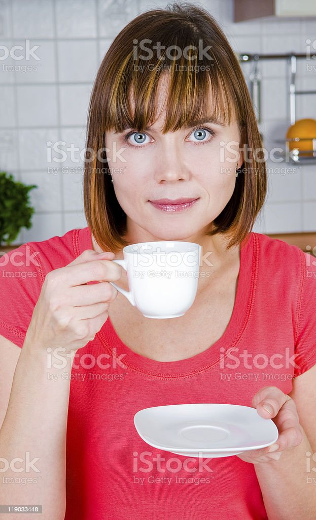 young woman enjoying a cup of coffee stock photo