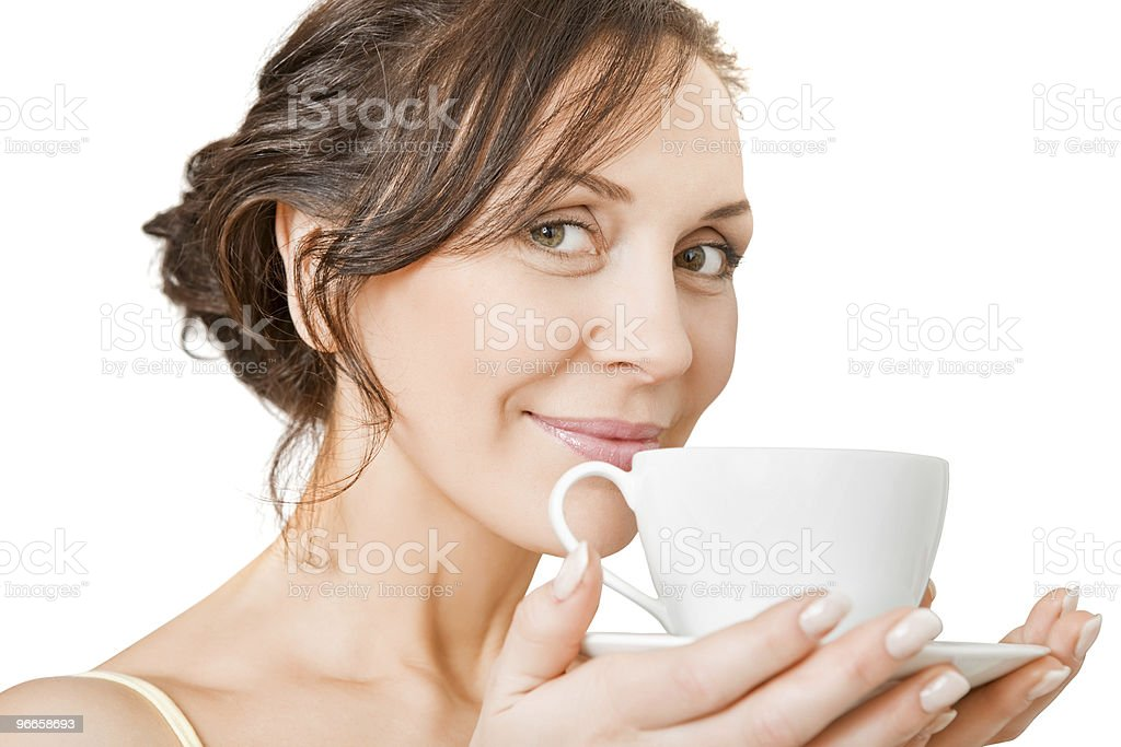young woman enjoying a cup of tea royalty-free stock photo