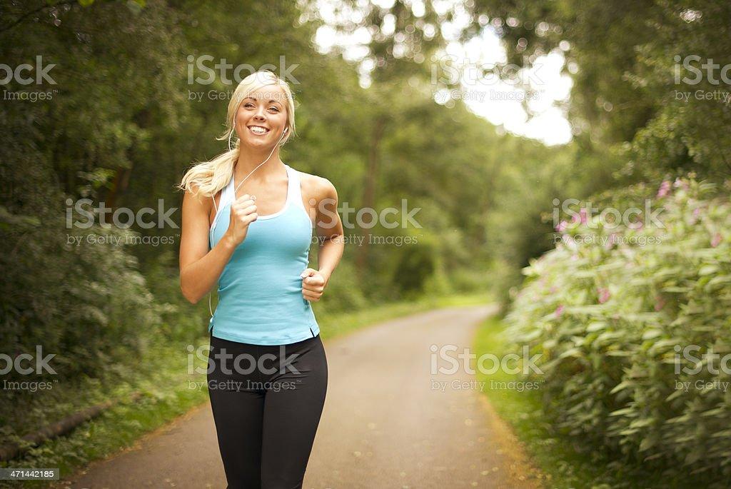Young woman enjoying a jog royalty-free stock photo