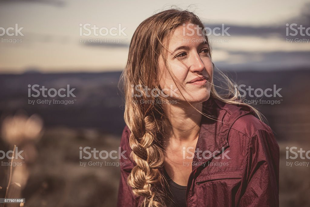 Young Woman Enjoying a Quiet Moment in Nature stock photo