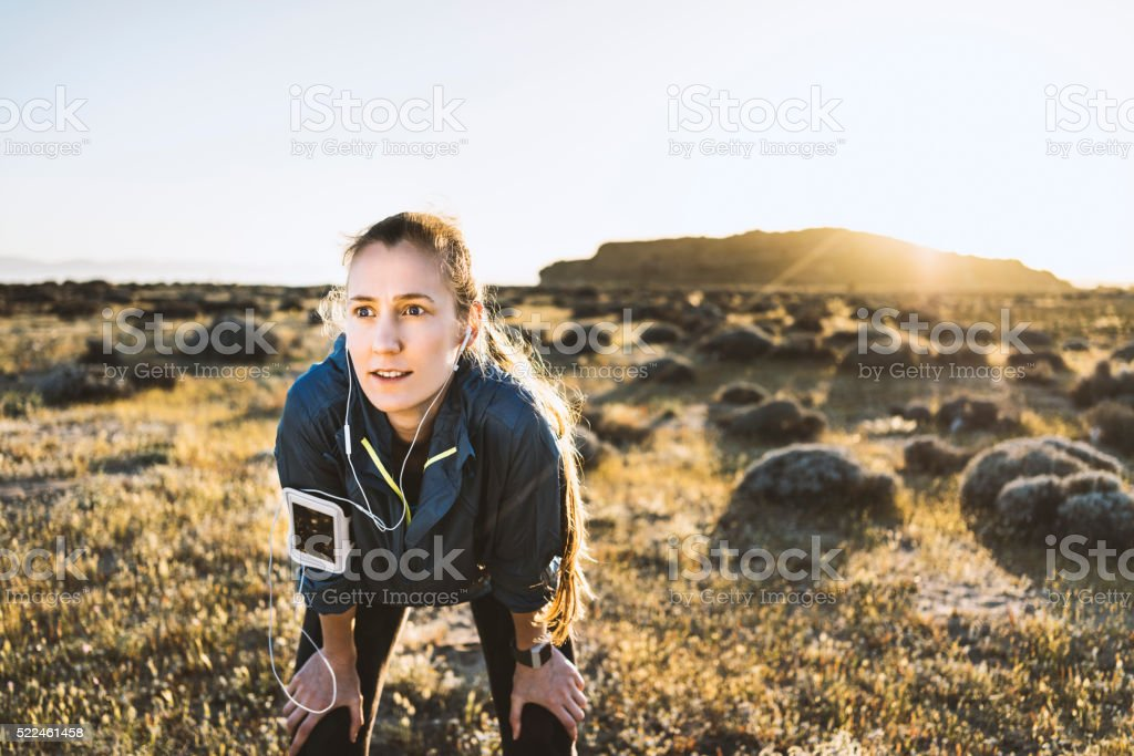 Young woman enjoying a run on a sunny day stock photo