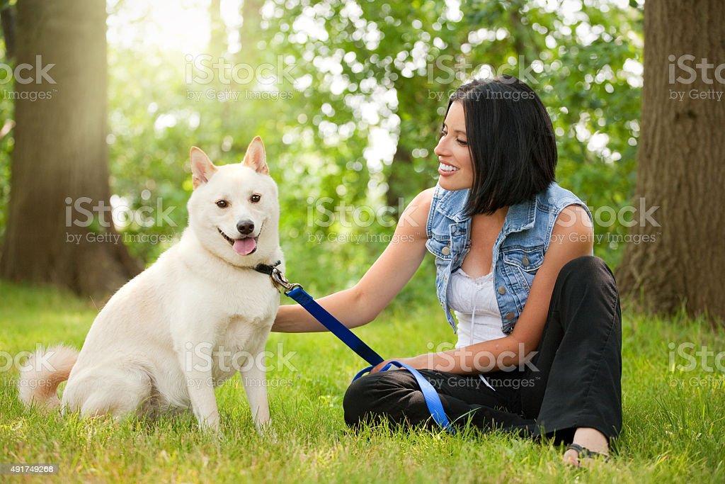 Young Woman Enjoying Beautiful Day WIth Dog stock photo