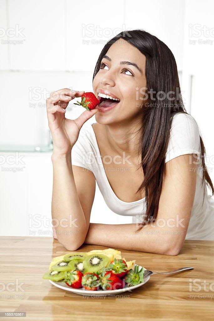 Young woman enjoying fruit salad royalty-free stock photo