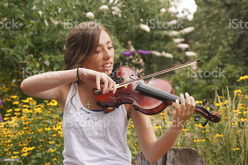 Young Woman Enjoying Her Instrument stock photo