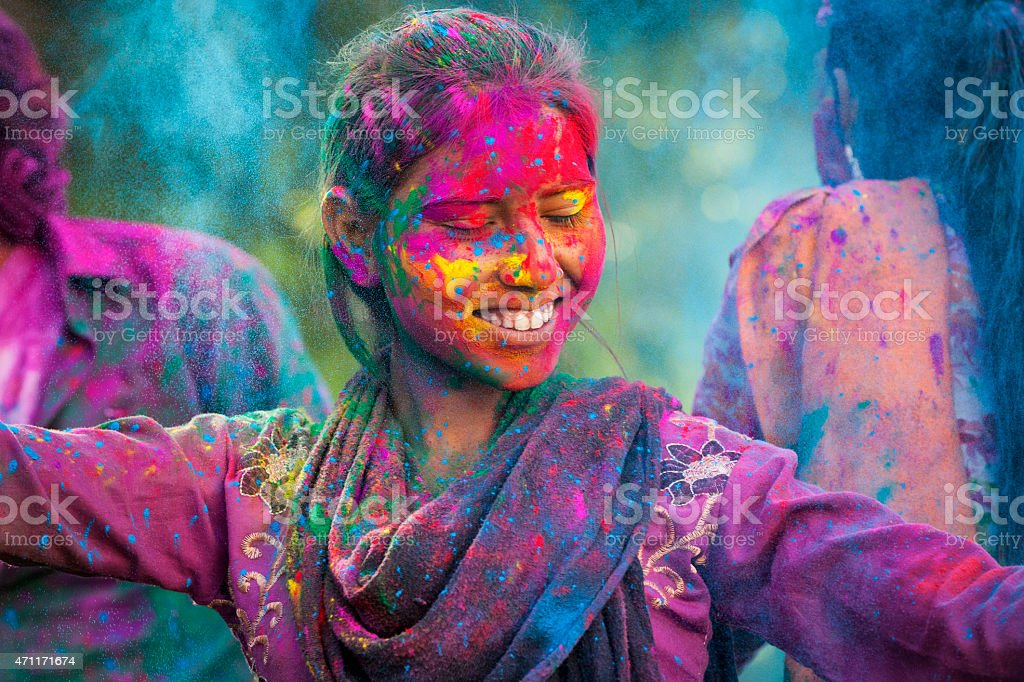Young Woman Enjoying Holi Festival stock photo