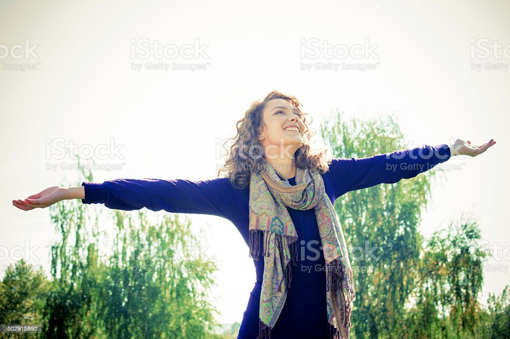 Young woman enjoying in nature stock photo