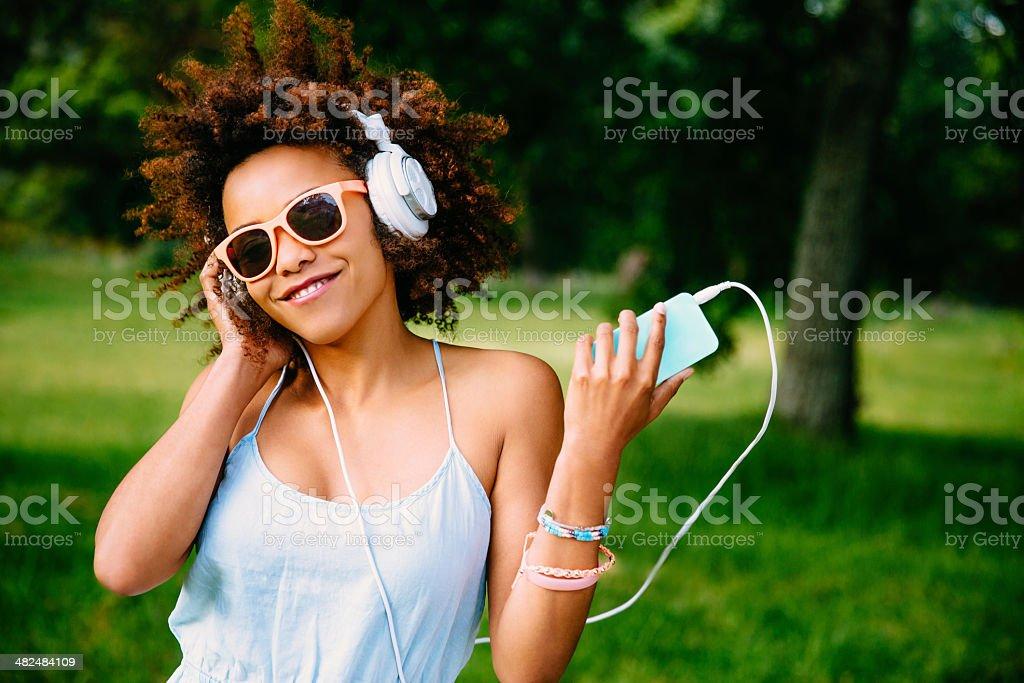 Young woman enjoying music on headphones stock photo