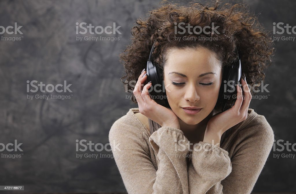 young woman enjoying music stock photo