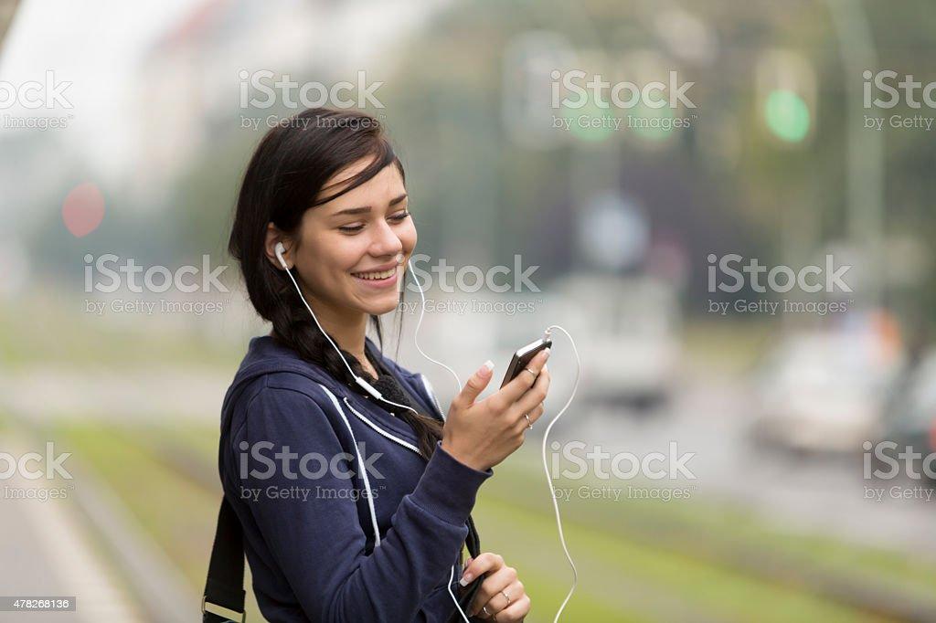 Young woman enjoying music through headphones stock photo