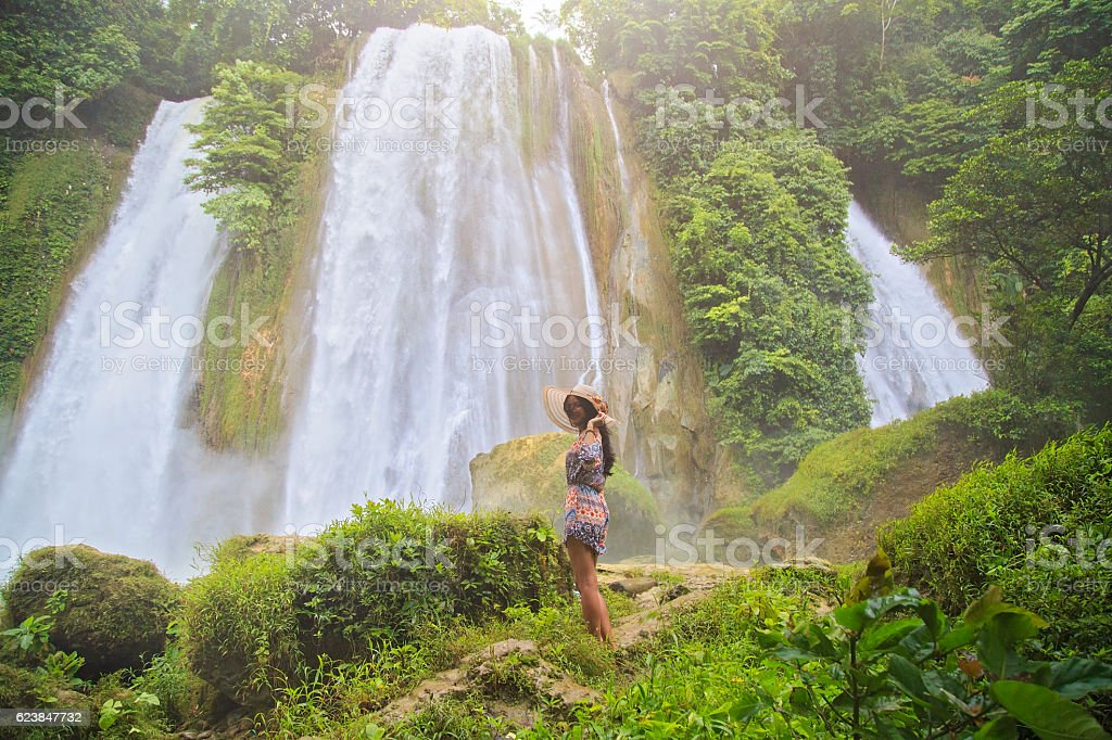 Young woman enjoying nature at Cikaso Waterfall stock photo