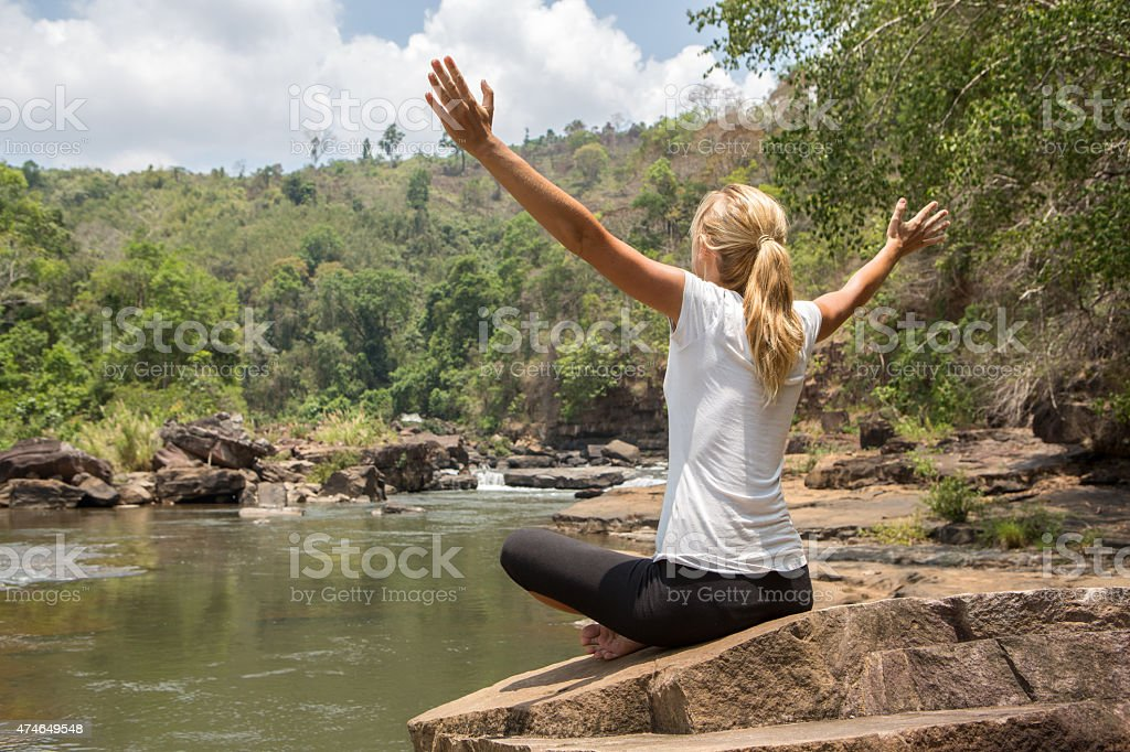 Young woman enjoying nature, freedom by the river stock photo