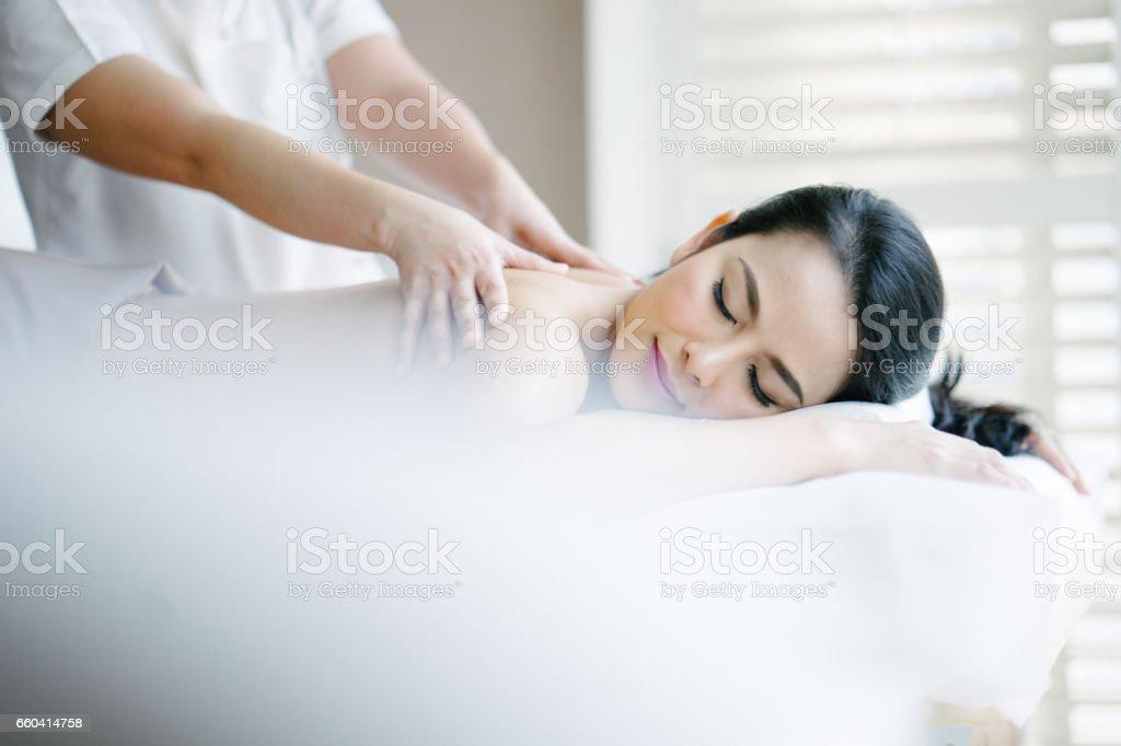 Young woman enjoying oil massage stock photo