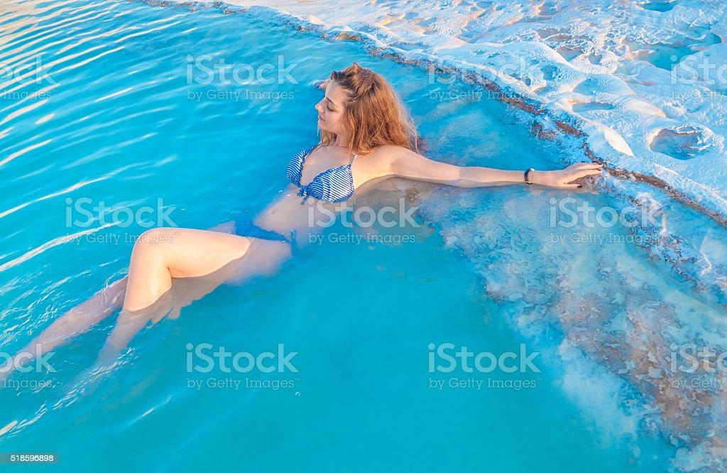 Young woman enjoying Pamukkale, Turkey. stock photo