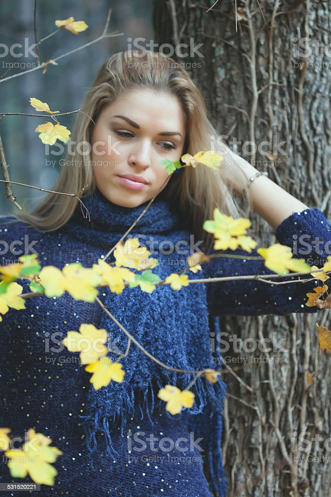Young woman enjoying park on an autumn day stock photo