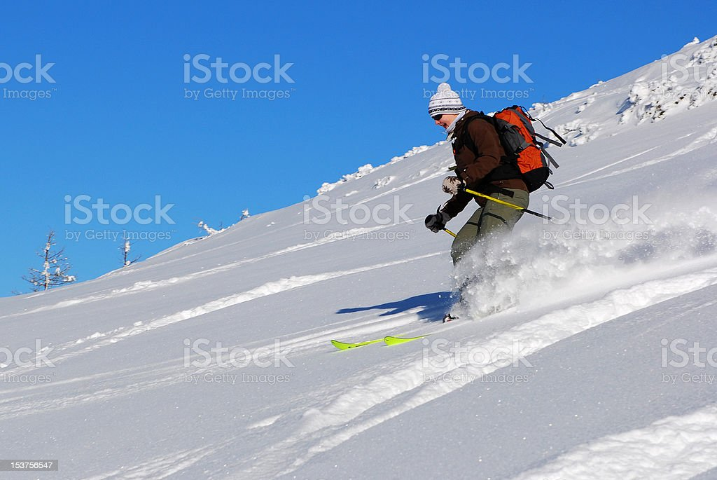 Young Woman enjoying skiing in powder royalty-free stock photo