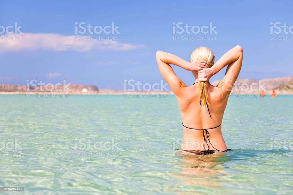 Young woman enjoying summer swim. stock photo