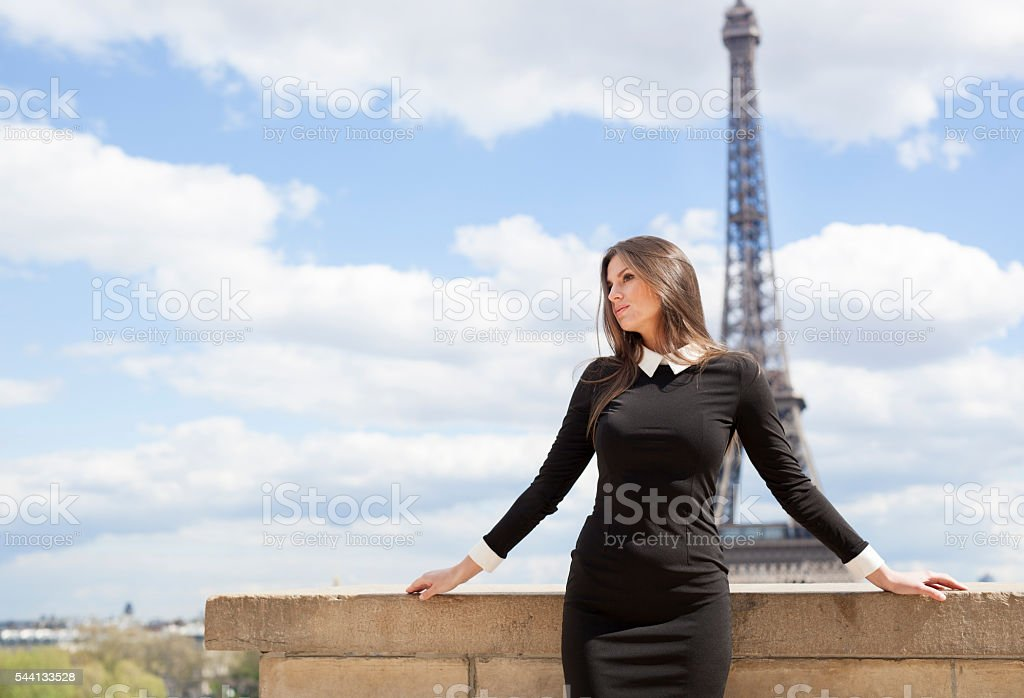 Young Woman Enjoying The Day Near The Eiffel Tower stock photo