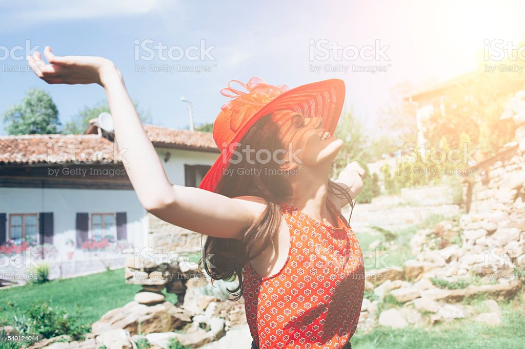 Young woman enjoying the sunlight stock photo