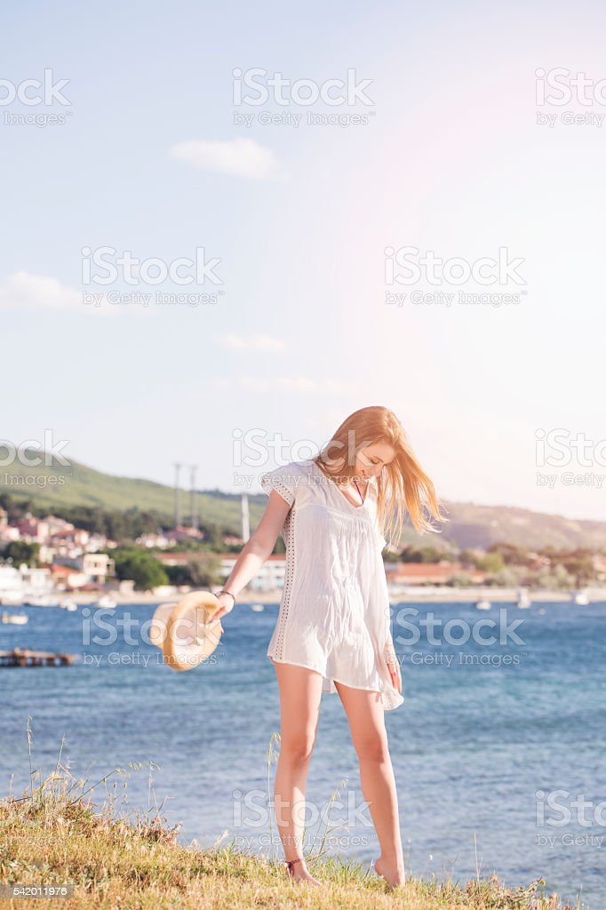 Young woman enjoying the sunset stock photo