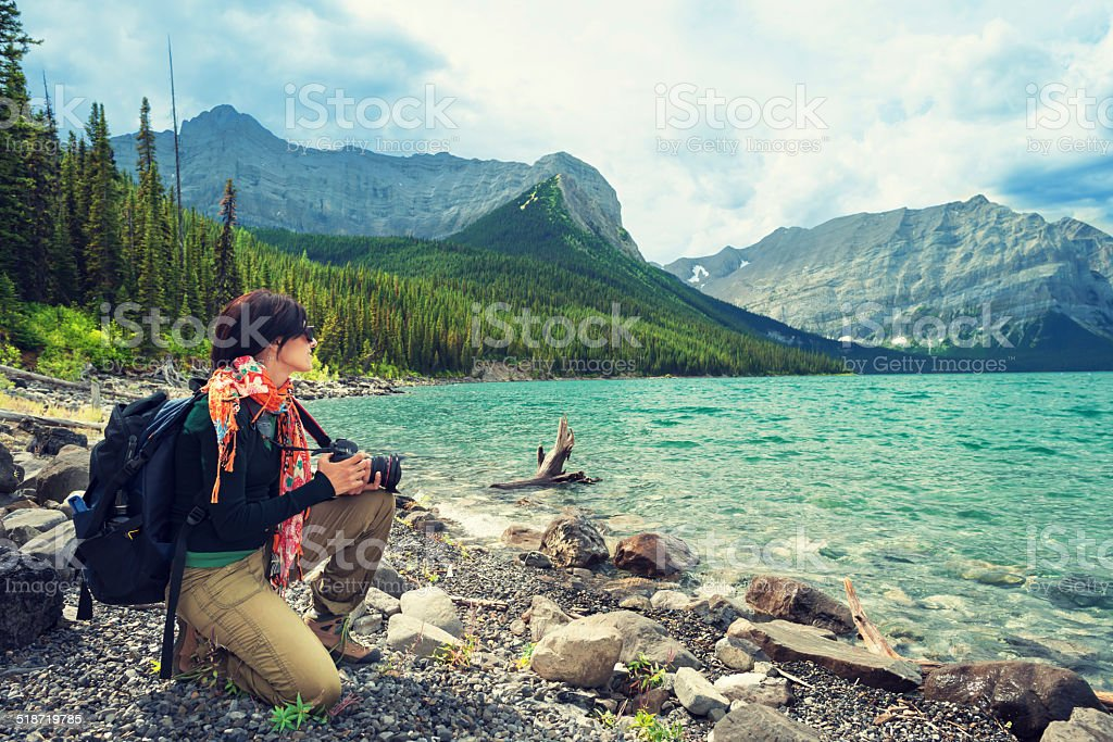 Young woman enjoying the view at Upper Kananaskis lake stock photo