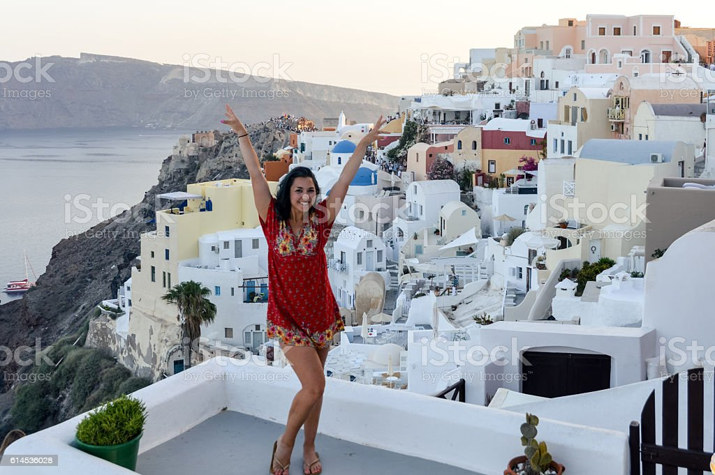 Young woman enjoying the views of Santorini Island - Greece stock photo
