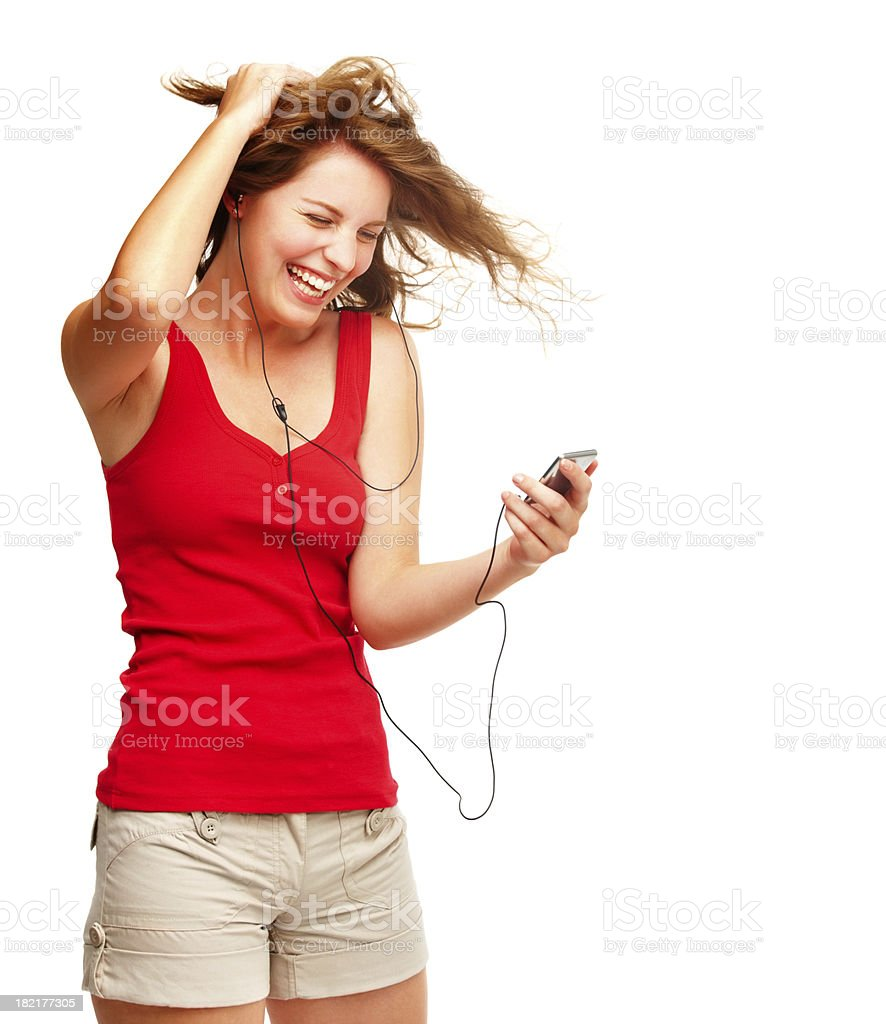 Young woman enjoying while listening to music royalty-free stock photo