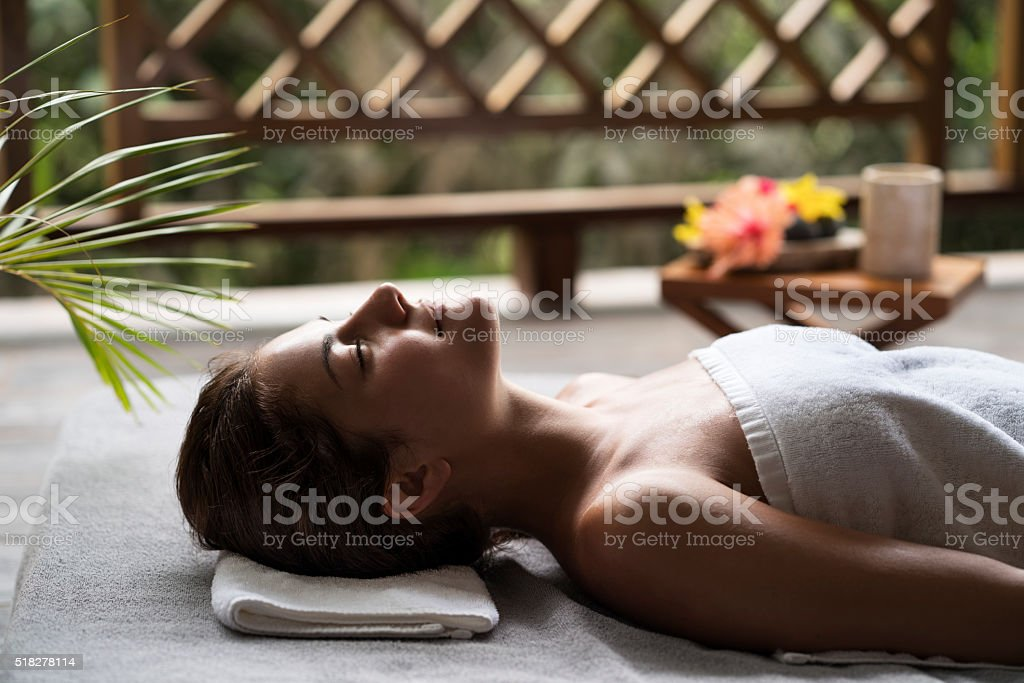 Young woman enjoying while waiting for her spa treatment. stock photo