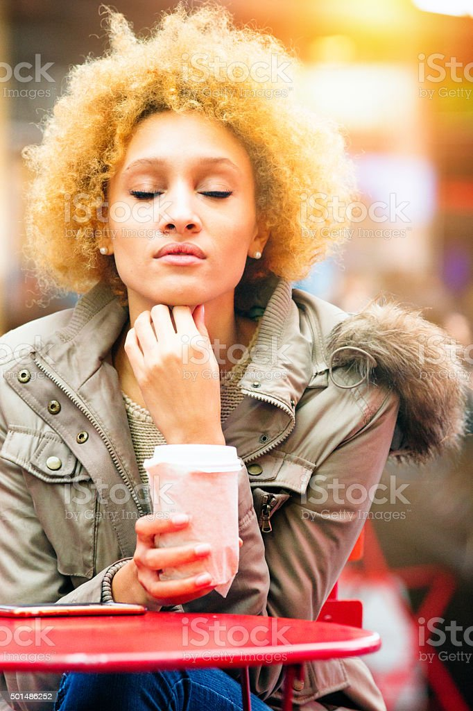 Young woman enjoys a minute of calm stock photo