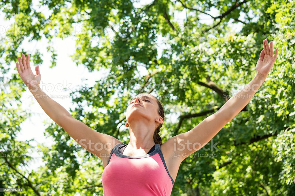 Young woman enjoys in nature and fresh air stock photo