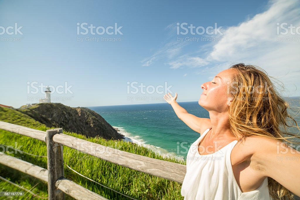 Young woman enjoys summer stock photo