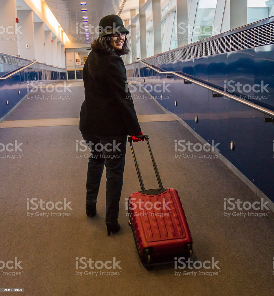 young woman entering the airport stock photo
